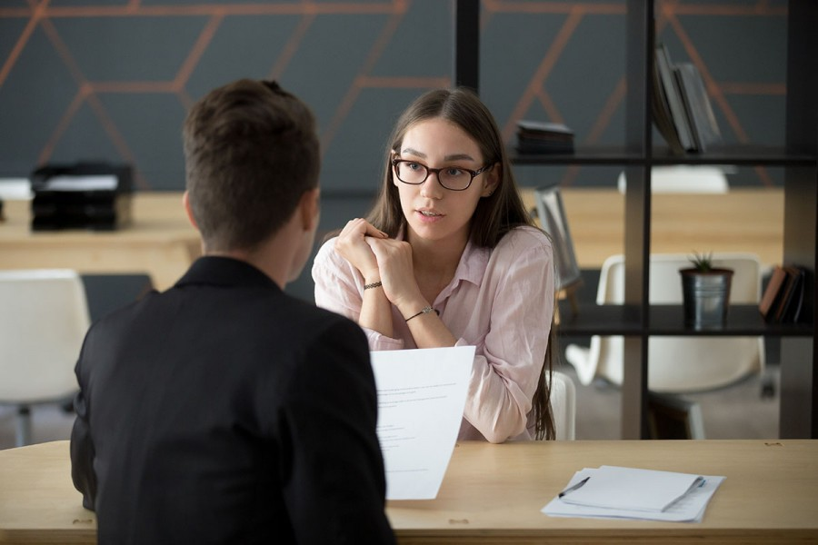 A business woman interviews a job candidate